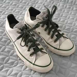 White Chuck Taylor All Stars in White and Green